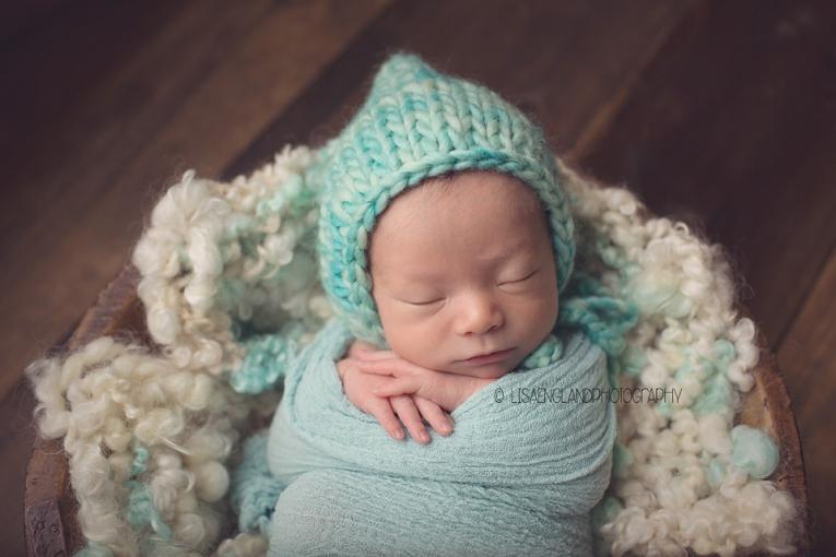 pretty baby girl in aqua hat