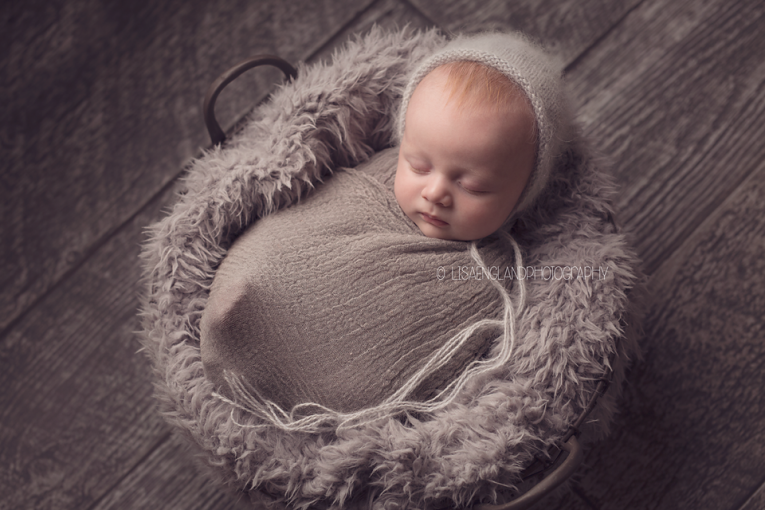 San Diego Newborn Photographer | 3 month old baby boy sleeping swaddled in grey