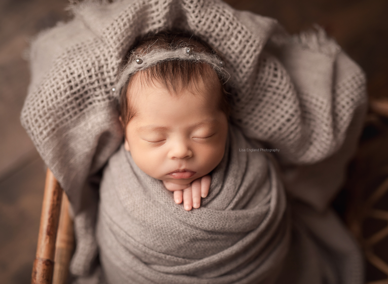 newborn wrapped posed