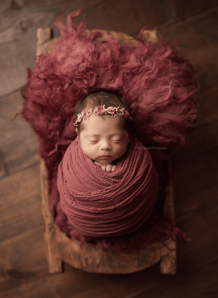 newborn wrapped in a basket